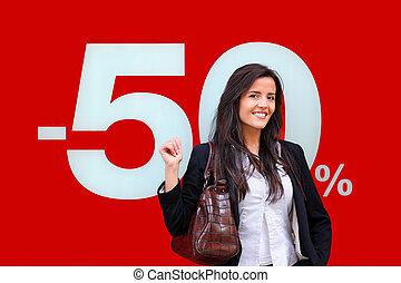 Young woman standing in front of shop window