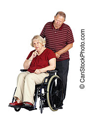 Senior couple with woman in wheelchair - Elderly or senior...