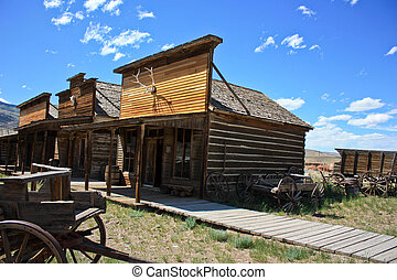 old wooden town - ghost town left in open plains to rot