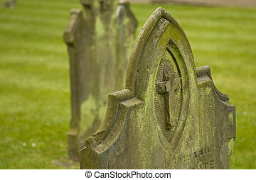 Gravestone with christian cross near St Albans cathedral, UK