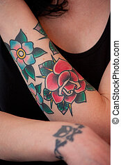 Flower and rose tattoo on female arm model released