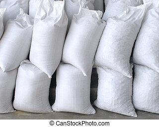 White sacks full with sand and rock - Pile of white sacks...