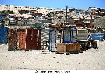 Shacks in Luderitz Namibia against a blue sky