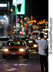 Taxi!!! - A man trying to get a taxi on the streets of New...