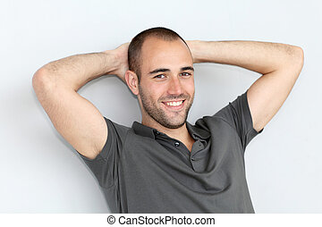 Portrait of relaxed man leaning on wall