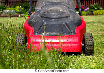 lawnmower - Lawnmower in a home flower garden