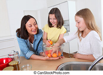 Mother and daughters in kitchen