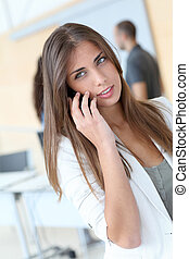 Portrait of student talking on mobile phone