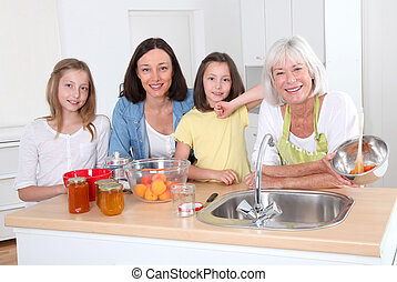 Portrait of grandmother, mother and kids in kitchen