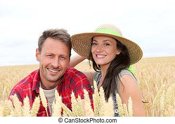 Portrait of happy couple in wheat field