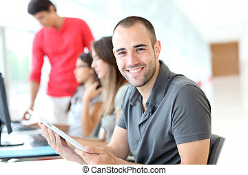 Portrait of smiling student in training course