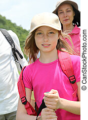 Portrait of young girl hiking with family