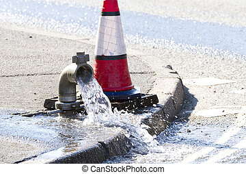 Water being released while a water main is repaired - Water...