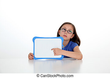Cute little girl holding message board