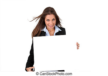Smiling businesswoman holding whiteboard