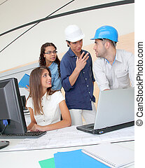 Group of young architects in business meeting