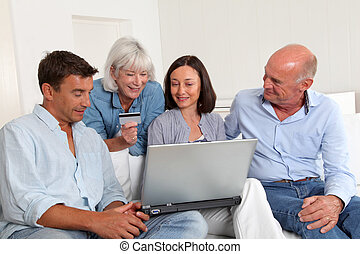 Senior people with couple doing shopping online