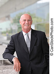 Portrait of smiling mature businessman