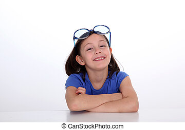 Portrait of little girl with funny sunglasses on