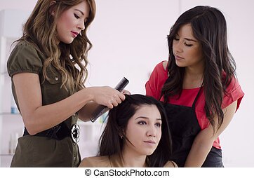 Hairstylist during training - Cute female hairstylist...