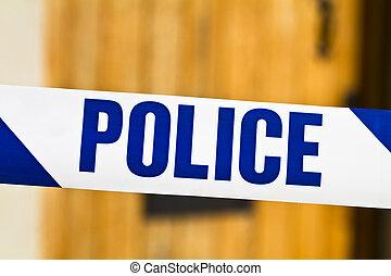 Police tape across an open door