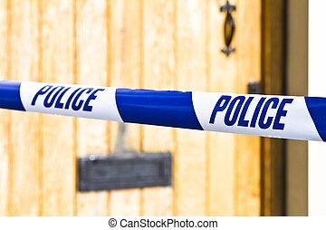 Police tape strung across a front door