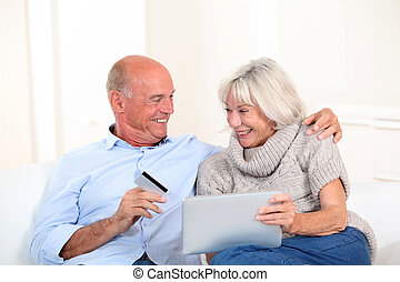 Senior couple doing online shopping