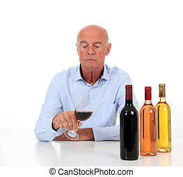 Portrait of winemaker tasting wine
