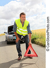 Man on the road with car breakdown waiting for rescue
