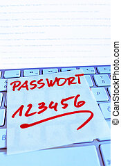 note on computer keyboard: password 123456 - a memo is on...
