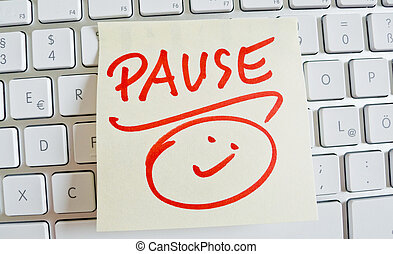 note on computer keyboard: pause - a memo is on the keyboard...
