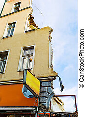 a house is demolished - in a city apartment building is...