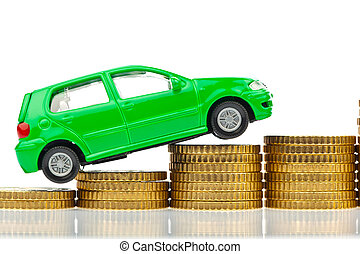 car and coins. rising car costs - a model car is on coins....