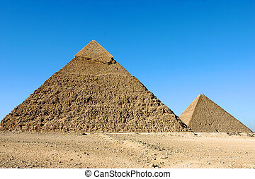Pyramids of giza in Cairo - Giza pyramids with a blue sky
