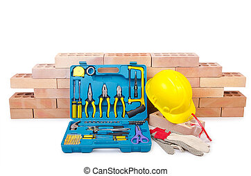 Construction concept with helmet and toolkit