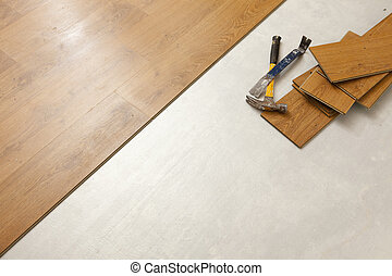 Hammer and Pry Bar with Laminate Flooring Abstract - Worn...