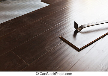 Pry Bar Tool with New Laminate Flooring Abstract