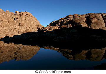 Wonderful lake in the desert of Sinai with sunrise with blue...