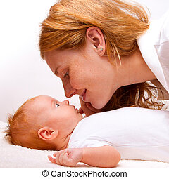 this is a cute newborn baby with mother