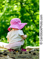 Alone baby at the forest - Alone infant baby at the green...