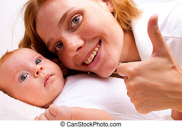 Cute newborn baby with mother