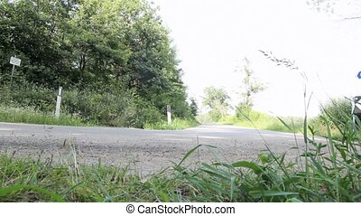 cycling - cyclist going around a bend in a country road