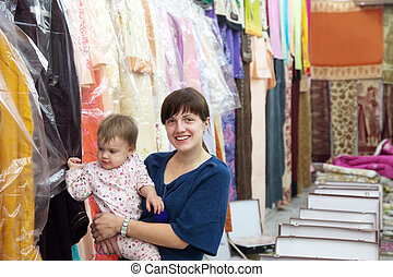 woman and child chooses clothes