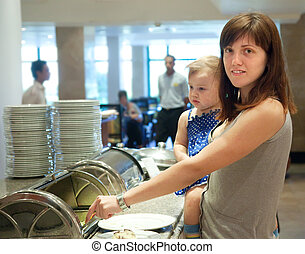 Woman with child in  buffet