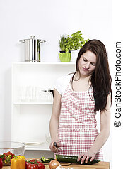 young woman is not happy about the working in her kitchen