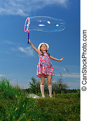 big bubble - Happy girl is playing with big bubbles in a...