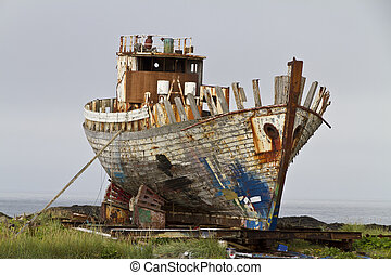 Old fishing trawler being broken up - Old rusty fishing...