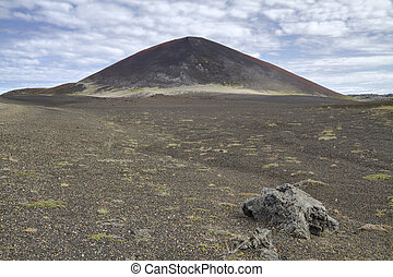 Icelandic volcanic cone and wasteland - Volcanic cone and...