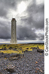 Icelandic lighthouse against a stormy sky on the...