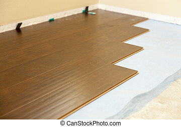 Newly Installed Brown Laminate Flooring Abstract